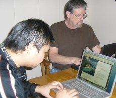 A photo of Robert Case and Jimmy Kung at work.